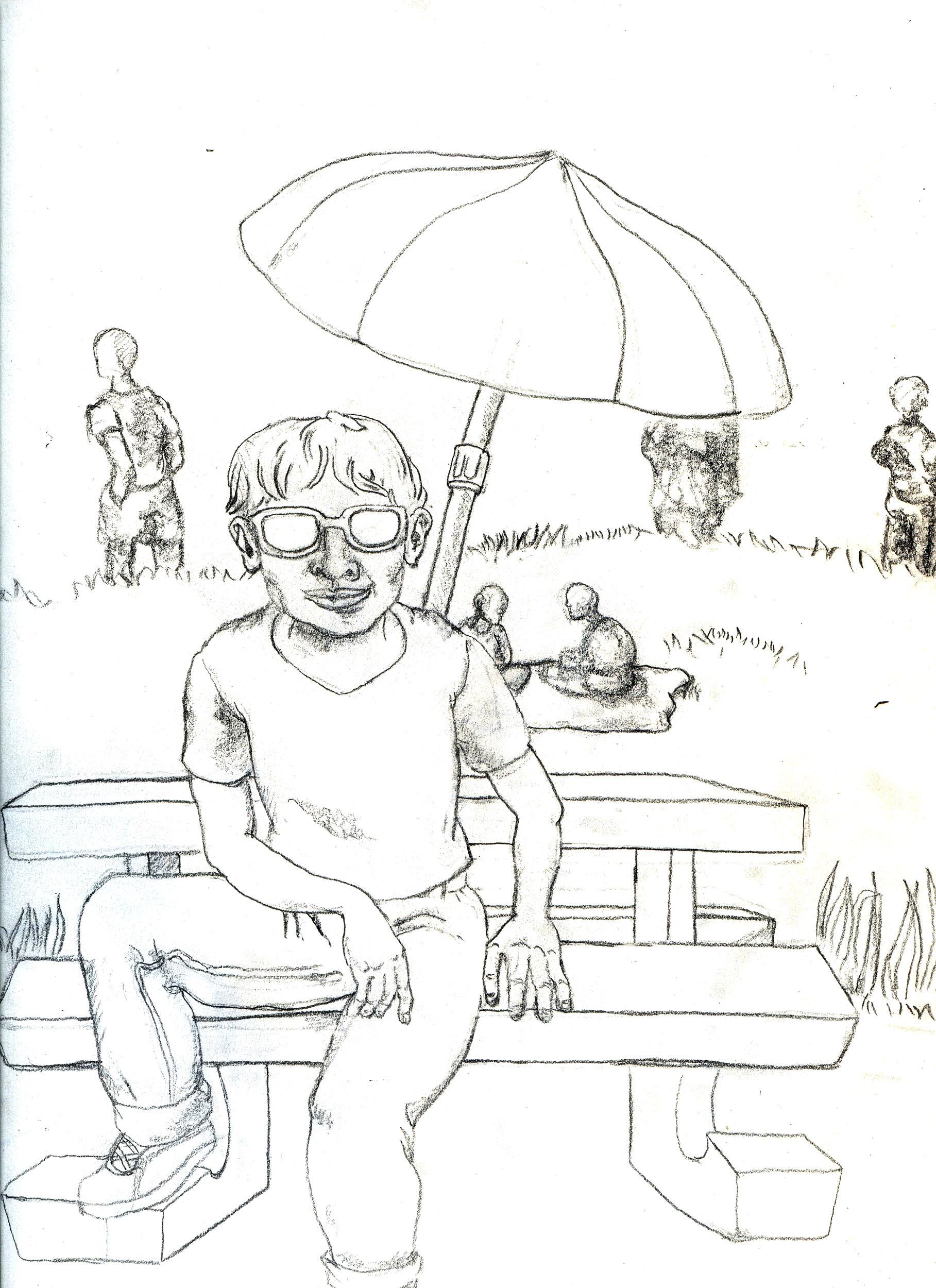man beneath a parasol at the park